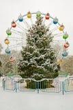 A christmas tree and ferris wheel Stock Photos