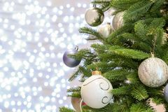 Christmas tree with festive decor against blurred royalty free stock photos