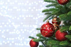 Christmas tree with festive decor against blurred lights royalty free stock photo