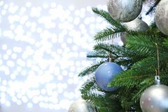 Christmas tree with festive decor against blurred lights royalty free stock image