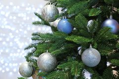 Christmas tree with festive decor against blurred lights royalty free stock photos