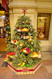 Christmas tree in the festive interior of Gum, Moscow, Russia. Moscow, Russia - December 16, 2016: Christmas tree c food in a festive interior of GUM. GUM is Stock Photo