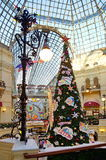 Christmas tree in the festive interior of Gum, Moscow, Russia. Moscow, Russia - December 16, 2016:  Decorative Christmas decoration State Department store. GUM Royalty Free Stock Photos