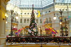 Christmas tree in the festive interior of Gum, Moscow, Russia. Moscow, Russia - December 16, 2016: Decorative Christmas decoration State Department store. GUM is Stock Image