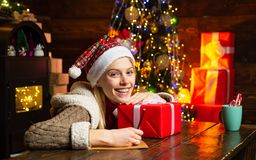 Christmas tree. Filled with happiness cheer and love. Girl enjoy cozy warm atmosphere christmas eve. Pleasant moments. Christmas joy. Woman wooden interior royalty free stock images