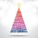 Christmas tree. Filled by Christmas and happy new year word cloud Royalty Free Stock Image