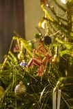 A christmas tree filled with ornaments and decorations. Glittering in the sunlight Royalty Free Stock Image