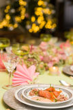 Christmas tree and fine dinner table Royalty Free Stock Photography