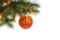 Christmas tree fir branch with hanging handmade craft new year toy ball pattern from red beads Royalty Free Stock Photo