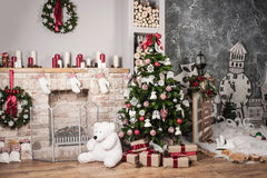 Christmas tree and fire-place. Toy bear and gifts royalty free stock photo