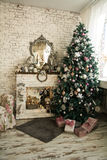 Christmas tree and fireplace with an armchair. Mirror on the brick wall background. Window curtains. Vertical image Royalty Free Stock Photo