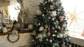Christmas tree and fireplace with an armchair stock video footage