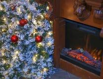 Christmas tree and fireplace. Stock Photo