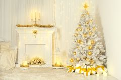 Christmas Tree and Fireplace, Gold Color Decorated Room Interior stock photography