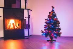 Christmas tree and fireplace Royalty Free Stock Photo