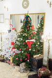 Christmas tree and fireplace in the living room Royalty Free Stock Image