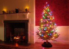 Christmas Tree and Fireplace in Traditional House  Royalty Free Stock Images