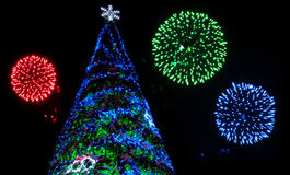 Christmas Tree and Fireworks Stock Image