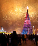 Christmas tree and fireworks Stock Photo