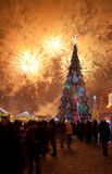 Christmas tree and fireworks Royalty Free Stock Image