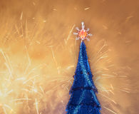 Christmas tree and fireworks Stock Images