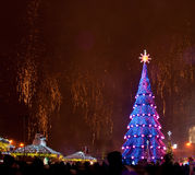 Christmas tree and fireworks Royalty Free Stock Photography