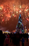 Christmas tree and fireworks Royalty Free Stock Images