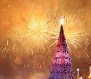 Christmas tree and fireworks Royalty Free Stock Photos