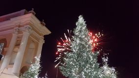 Christmas tree with fireworks. Behind stock photography