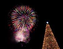 Christmas tree fireworks eve lights santa. Colorful fireworks and huge Christmas tree decoration on Christmas Eve Stock Photo