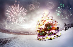 Christmas tree with fireworks Stock Images