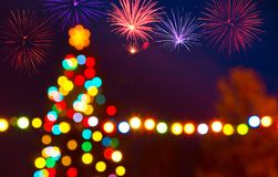 Christmas Tree with a Fireworks by Night Royalty Free Stock Images