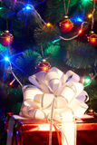 Christmas tree with flash and  gift box. Royalty Free Stock Photo