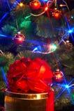 Christmas tree with flash and  gift box. Stock Image
