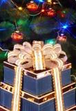 Christmas tree with flash and  gift box. Stock Photos