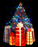 Christmas tree with flash and group gift box. Stock Image