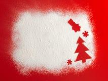 Christmas tree on flour background. White flour looks like snow. Stock Photos