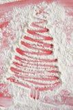 Christmas tree on flour background. White flour looks like snow. Stock Photography