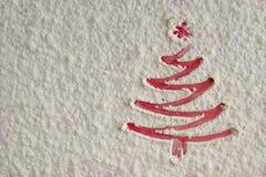 Christmas tree on flour background. White flour looks like snow. Stock Image