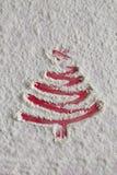 Christmas tree on flour background. White flour looks like snow. Royalty Free Stock Photos