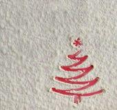 Christmas tree on flour background. White flour looks like snow. Royalty Free Stock Photography