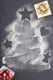 Christmas tree on flour with gift box Royalty Free Stock Image