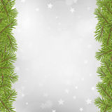 Christmas tree frame on blurred silver star background Stock Image