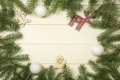 Christmas tree frame branches, balls and christmas toys on wooden background with copy space. Horizontal template for design. Christmas tree frame branches stock photo