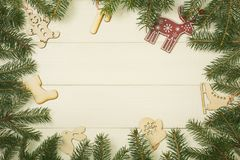 Christmas tree frame branches and christmas toys on wooden background with copy space. Horizontal template for design. Christmas tree frame branches and stock photo