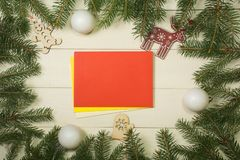 Christmas tree frame branches, envelopes, balls and christmas toys on wooden background with copy space. Horizontal template for d. Christmas tree frame branches royalty free stock photos