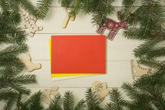 Christmas tree frame branches, envelopes and christmas toys on wooden background with copy space. Horizontal template for design. Christmas tree frame branches stock image