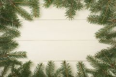Christmas tree frame branches on wooden background with copy space. Horizontal template for design. Christmas tree frame branches on wooden background with copy stock photos