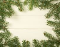 Christmas tree frame branches on wooden background with copy space. Horizontal template for design. Christmas tree frame branches on wooden background with copy royalty free stock photos