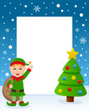 Christmas Tree Frame - Cute Green Elf. Christmas vertical photo frame with a Christmas tree and a happy green elf smiling and holding the sack of the gifts in a Royalty Free Stock Photos